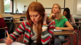 Blonde student thinking in class stock video footage