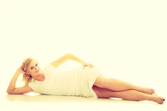 Blonde stunning young lady in white. Royalty Free Stock Photos