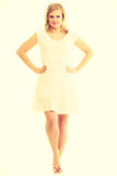 Blonde stunning young lady in white. Royalty Free Stock Photography