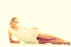 Blonde stunning young lady in white. Royalty Free Stock Images