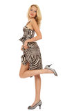 Blonde in stylish dress. Beautiful slim tanned blonde in stylish dress over white background stock photography