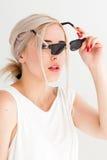 Blonde stylish girl wears black sunglasses Royalty Free Stock Photography