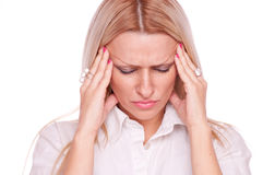 Blonde suffering from head pain Stock Photography