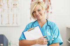 Blonde surgeon. Portrait of smiling blonde female surgeon Royalty Free Stock Images
