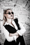 Blonde surrounded with newspapers Royalty Free Stock Image