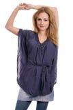 Blonde sveglio con la camicetta blu Fotografie Stock