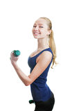 Blonde svelte girl with dumbbells Stock Photos