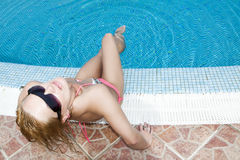 Blonde at swimming pool Stock Images