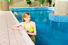 Blonde in swimming pool. Blonde woman in swimming pool. She's smiling stock photos