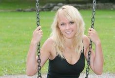 Blonde on swing Stock Photo