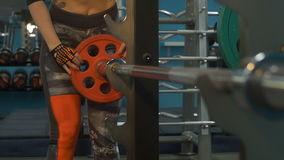 Blonde swinging in the gym. A beautiful girl goes in for sports in a sports club stock video