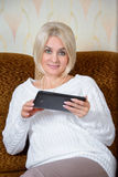 Blonde with a tablet PC Royalty Free Stock Photo