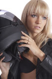 Blonde takes motorcycle helmet Royalty Free Stock Photography
