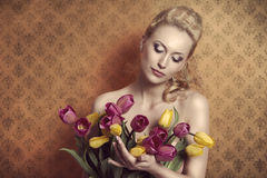 Blonde taking colourful bouquet vintage Stock Images