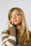 Blonde talking by mobile. Young pretty blonde talking by mobile phone Royalty Free Stock Photography