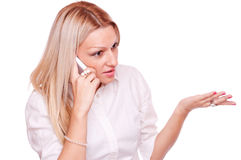 Blonde talking on a mobile Stock Image