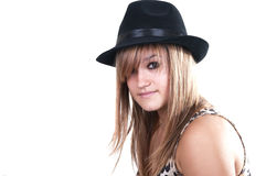 Blonde teen with black hat. On white background Stock Photos