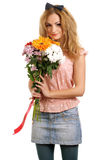Blonde teen with a bouquet of flowers Stock Photography