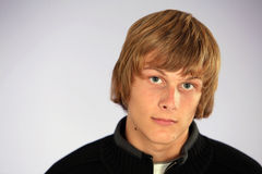 Blonde teen boy. Headshot of handsome teen boy Royalty Free Stock Photography