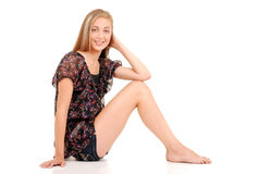 Blonde teen girl sitting Stock Photos