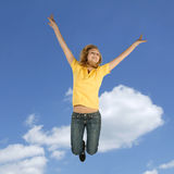 Blonde teen jumping Stock Images