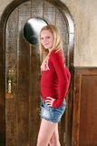 Blonde teen in mini skirt. Portrait of pretty young teen girl with long blonde hair Royalty Free Stock Photos