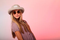 Blonde teenage girl hat and sunglasses Royalty Free Stock Photography