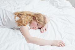 Teenager girl on bed Royalty Free Stock Images