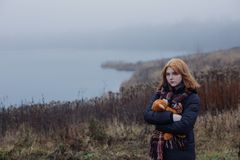 Free Blonde Teenager  Girl Hugging  Teddy Bear By Foggy  Lake.  Concept Of Adolescence And Adolescent Problems Royalty Free Stock Images - 167422009