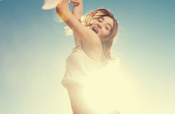 Blonde teenager girl jumping happy with the blue Royalty Free Stock Photos