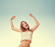Blonde teenager girl jumping happy with the blue Royalty Free Stock Images