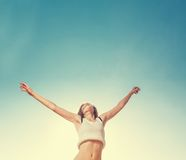 Blonde teenager girl jumping happy with the blue Stock Photography