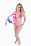 Blonde teenager holding a beach ball under her arm Stock Photos