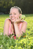 Blonde teenager lying in the grass royalty free stock photography