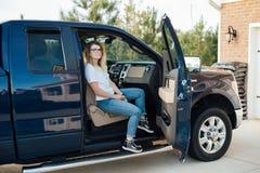 Blonde teenager receives a car as present stock photos