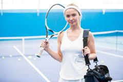 Blonde Tennis Player in Court stock photo