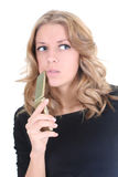 Blonde thinking woman with phone Stock Photos