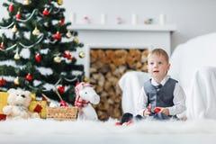 Blonde toddler boy playing stock photos