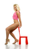 Blonde with toy chair Stock Photography