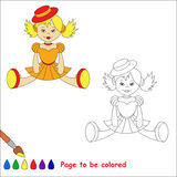 Blonde toy doll in orange dress and red hat. Stock Photos