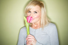 Blonde with tulip Royalty Free Stock Photography