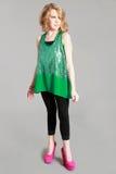 Blonde tween girl in sequin green shirt Royalty Free Stock Photography