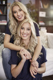 Blonde twins at home Royalty Free Stock Photos