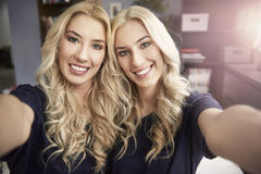 Blonde twins at home Royalty Free Stock Photography