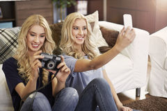Blonde twins at home Stock Photography