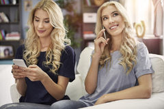 Blonde twins at home Royalty Free Stock Images