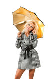 Blonde with an umbrella. Beautiful blonde in a plaid coat with umbrella Stock Photo