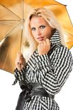 Blonde with an umbrella Stock Images
