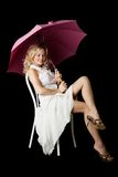 Blonde with an umbrella. Isolated on a black background Stock Photo