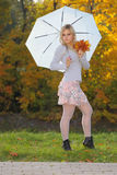 Blonde with an umbrella in autumn park Royalty Free Stock Photo